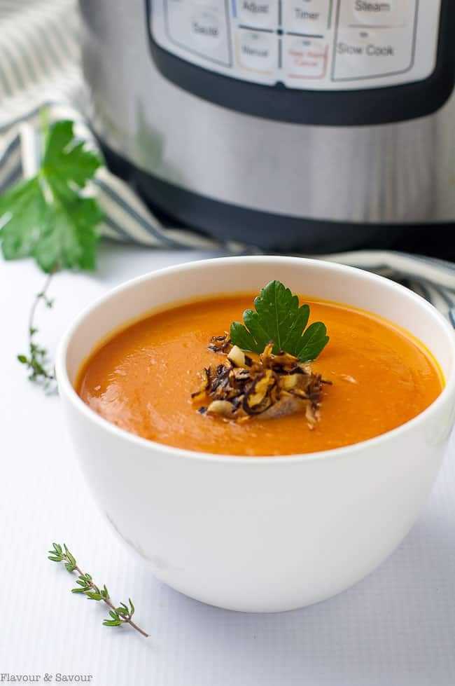 A warm bowl of Instant Pot Carrot Ginger Soup with Apple is always popular on a chilly day