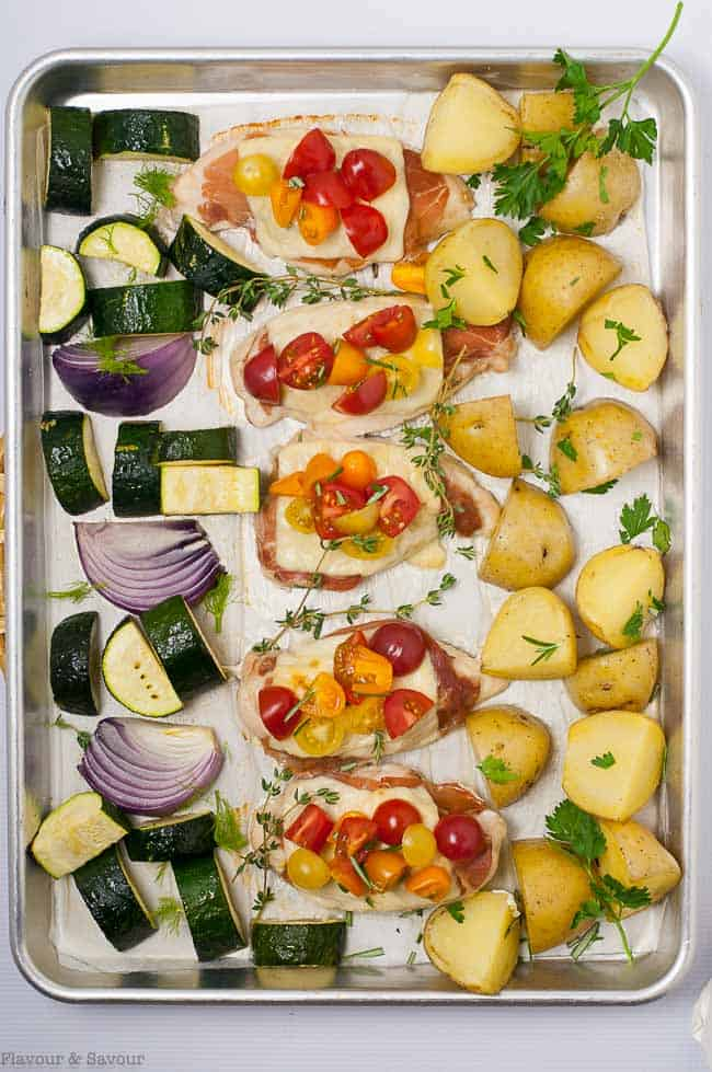 Baked Prosciutto and Cheesy Chicken Sheet Pan Dinner. Overhead view on a sheet pan.