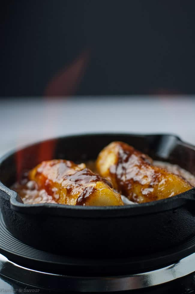 Igniting the rum for Caribbean Rum Bananas Flambé with Amaretto