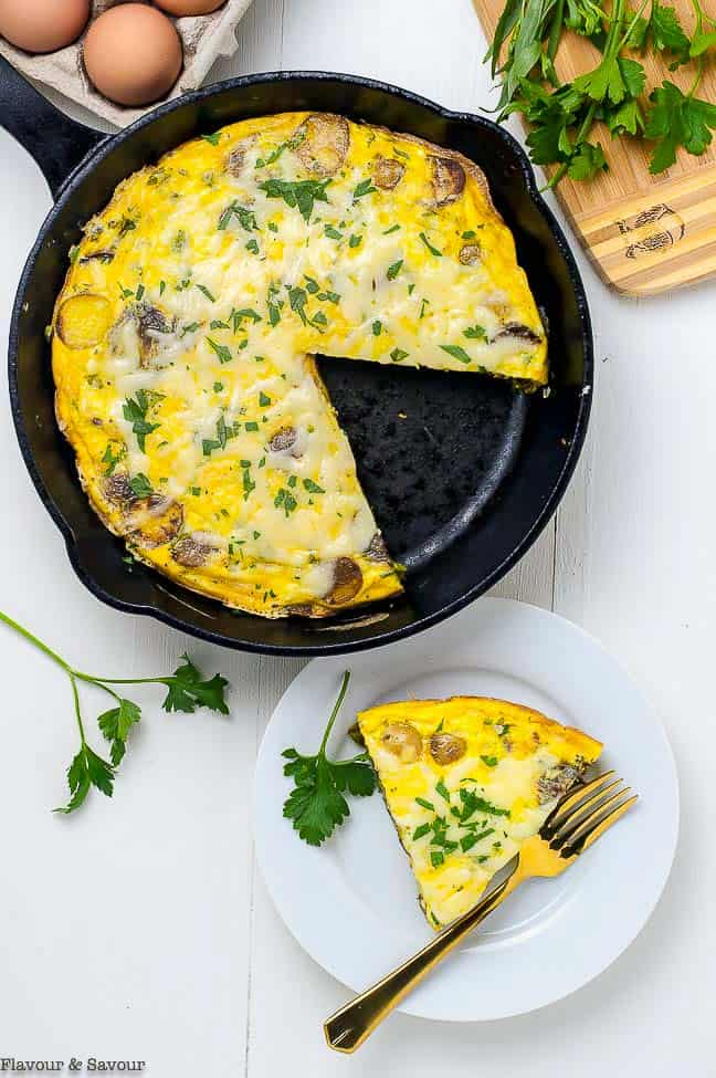 Double Cheese Asparagus Leek Frittata in skillet. One of 15 Spring Brunch Recipe Ideas by Flavour and Savour.