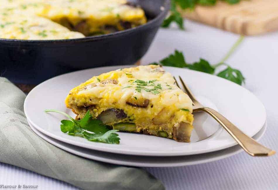 Double Cheese Asparagus Leek Frittata on a plate.