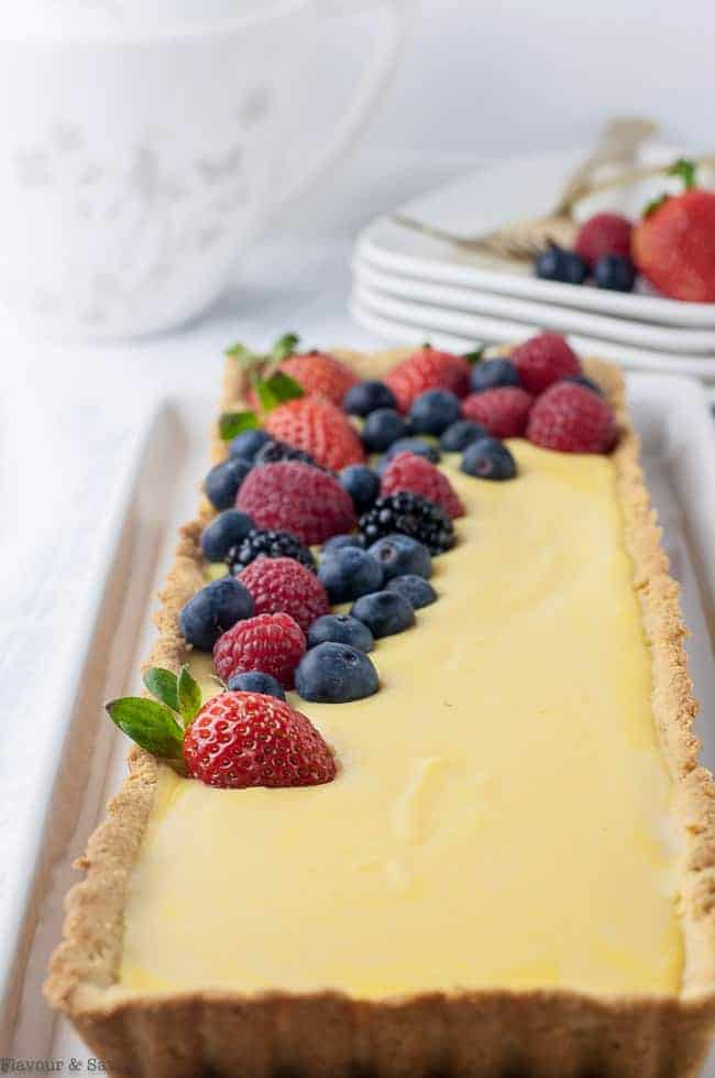 Gluten-Free Lemon Curd Tart with mixed berries close up view