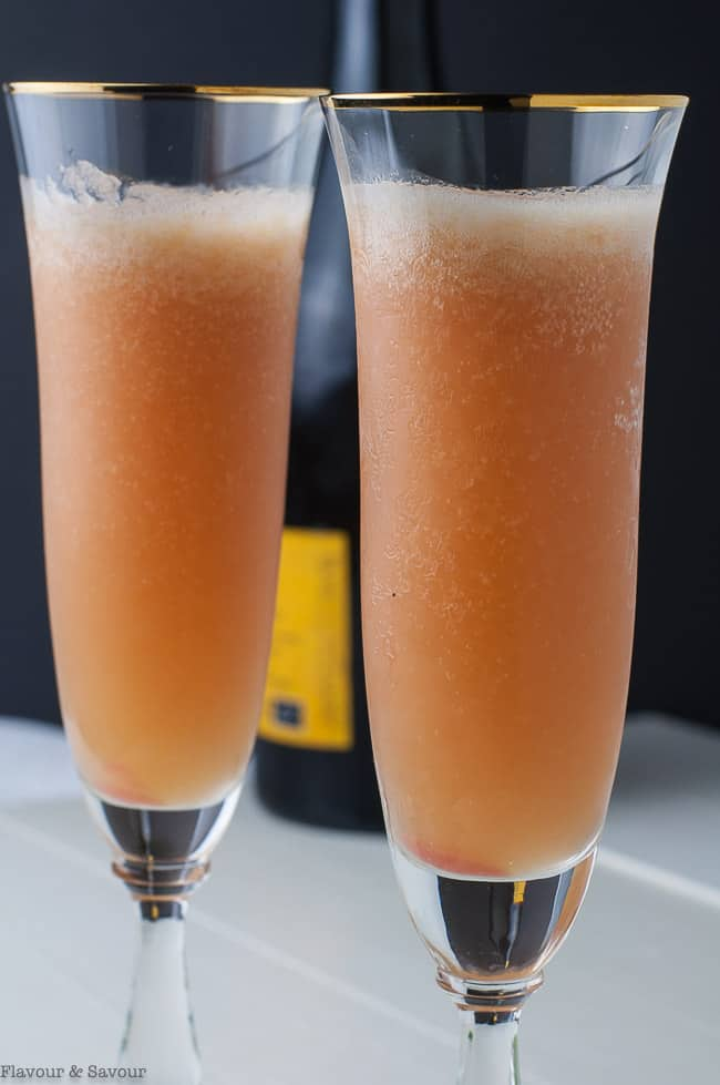 Close up view of two flutes of Rhubarb Bellini Prosecco Cocktail