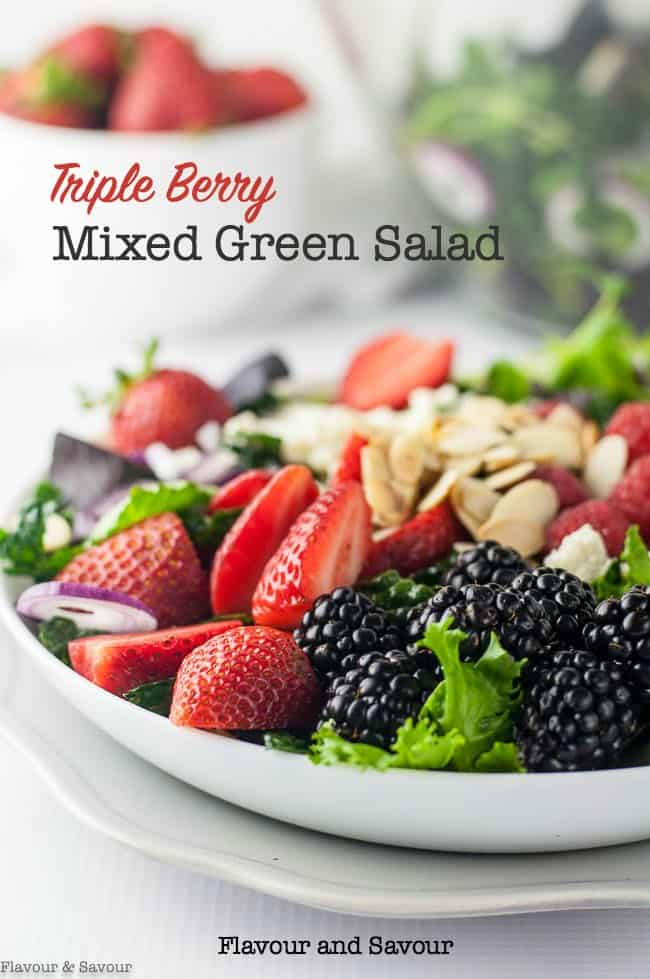 Triple Berry Mixed Green Salad with strawberries, blackberries, raspberries, feta cheese (or goat cheese) and toasted almonds. A perfect potluck salad for spring and summer. #strawberry_salad #raspberry_salad #blackberry_salad  #kale_salad #feta #toasted_almonds