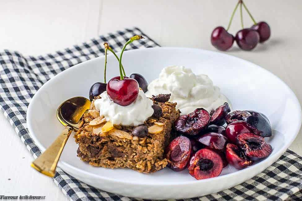 Chocolate Espresso Baked Oatmeal in a white bowl with cherries