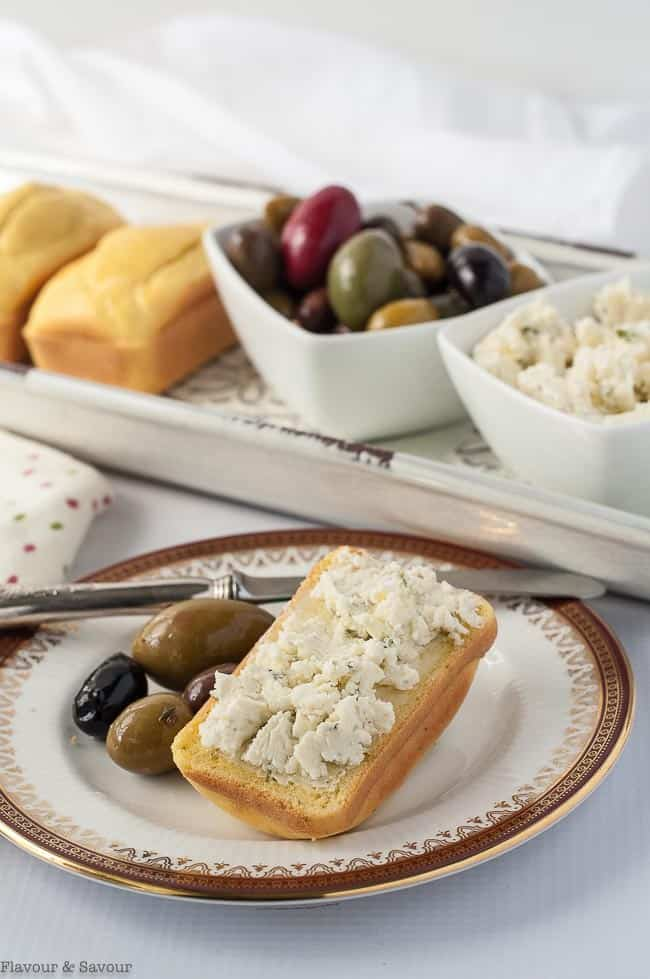 Keto Low-Carb Mini Loaves served with cream cheese and olives.