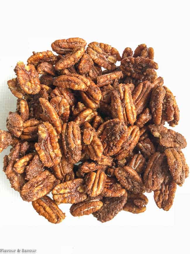 Low-Carb Pumpkin Spice Roasted Pecans in a bowl ready for the oven