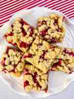 Pomegranate Apple Crumble Bars on a white plate
