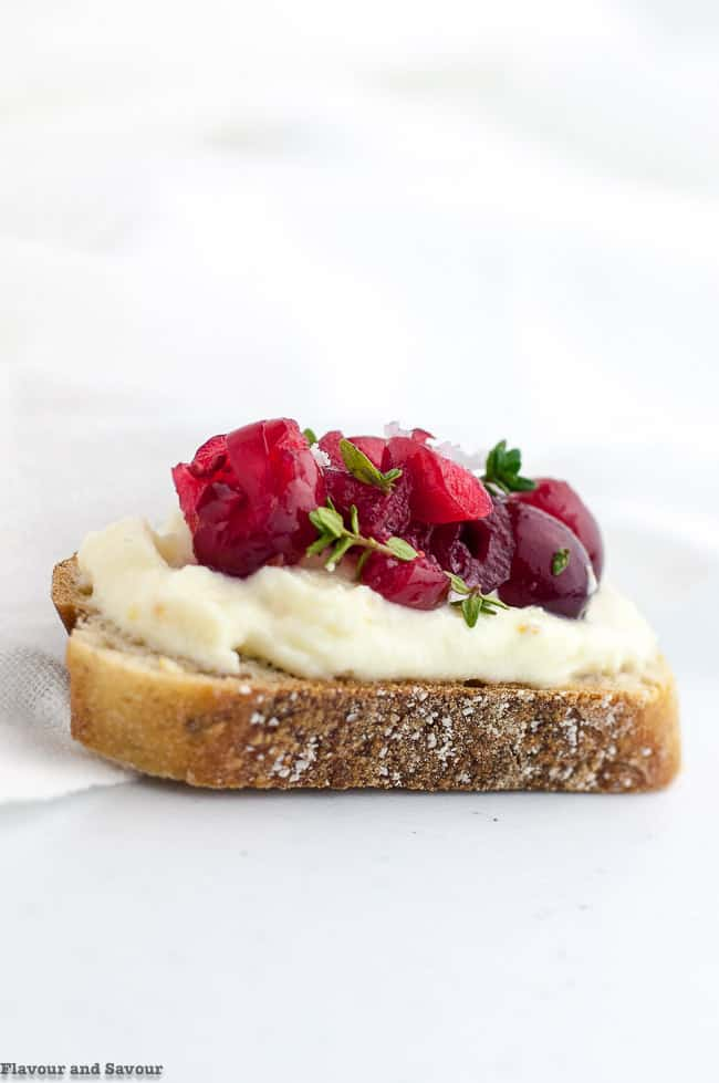 Cranberry Whipped Ricotta Crostini with Thyme leaves