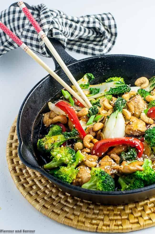Japanese Chicken Stir Fry in cast iron pan with chopsticks