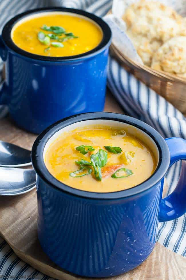 Two blue mugs of Sweet Potato Corn Chowder