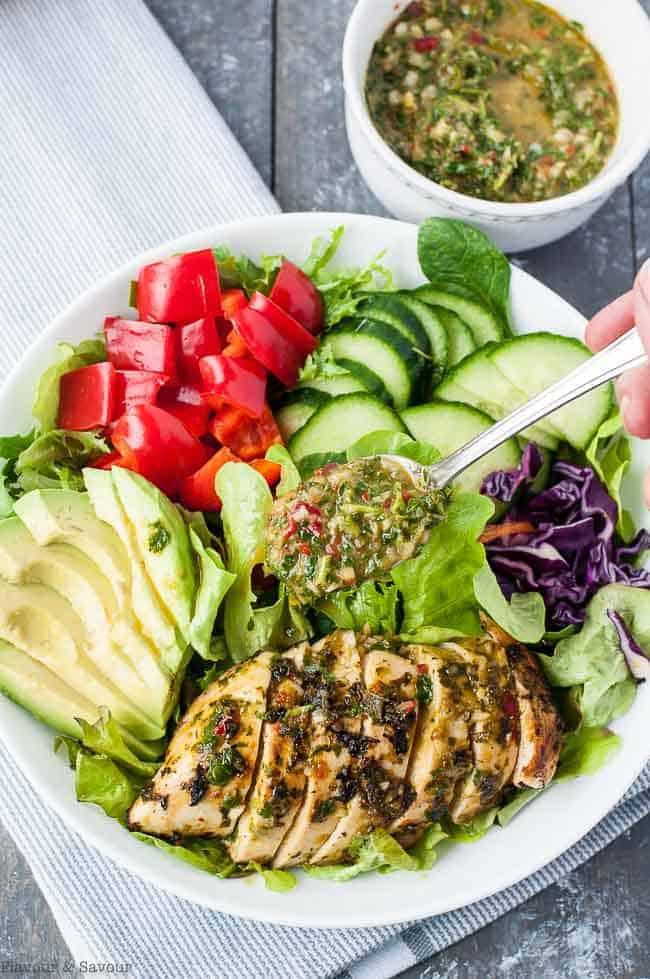 Adding dressing to Chimichurri Chicken Dinner Salad