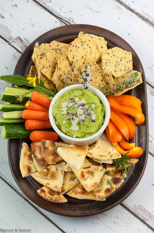 Avocado Feta Herb Dip with pita chips and crudites