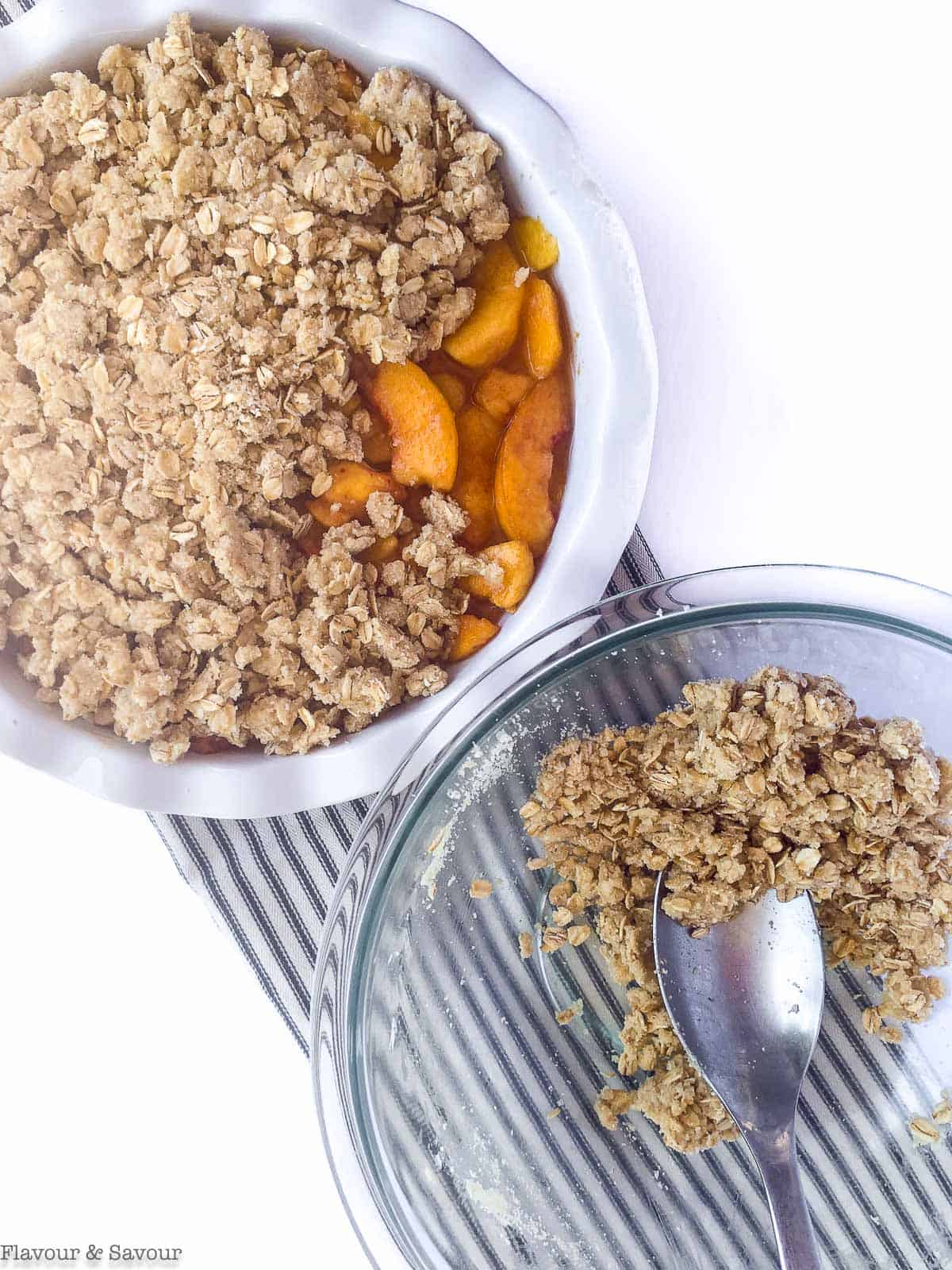 adding topping to Peach Crisp