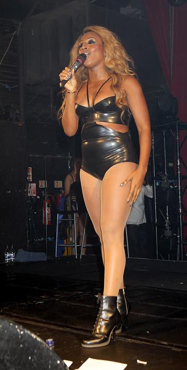 Alexandra Burke poured her curves into a leather body, complete with poorly-judged compression tights