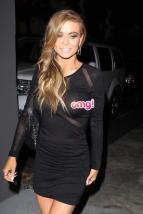 Carmen Electra flashes a peek after a dinner - next time she'll hopefully remember to put on a bra