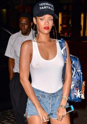 Rihanna forgets to wear her bra thus revealing her boobs and nipple piercing