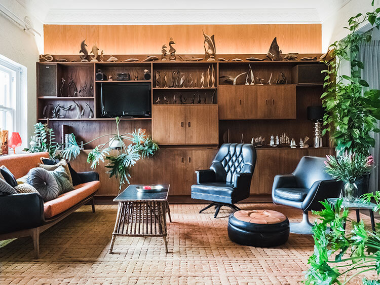 A collection of vintage furniture and cabinets that steal the show with their aged black and brown exteriors.
