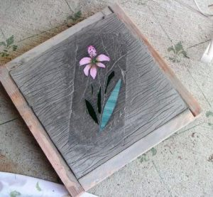 Lily, made from stained glass pieces and set in the concrete pavers.