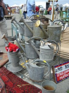 Watering cans wait for new owners