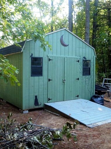"""Shed in front garden....needs tidying and flowers and whatnot.... Woodland Green from the Home Depot....yes, it's been loads of fun! I plan to finish it up in spring."""