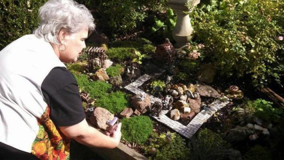 """One of my best memories will be of Jeanie getting down on her knees in the wet grass to get a closer look at Sandy's wonderful fairy garden!"" says Tonya."