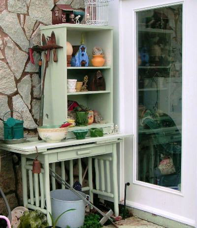 Vintage pottery and other treasures fill Becky's potting bench