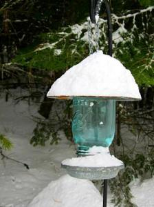Kirk Willis's Mason jar birdfeeder, stacked with snow