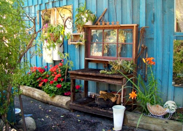 "Julie Scherbarth says, ""My side yard with potters bench my husband made."""