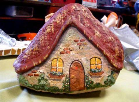 Sue from Flea2Fab made this cute weatherproof gnome or fairy home from a stone!  The roof 'eaves' are formed with wood putty and all is painted.  Fun!