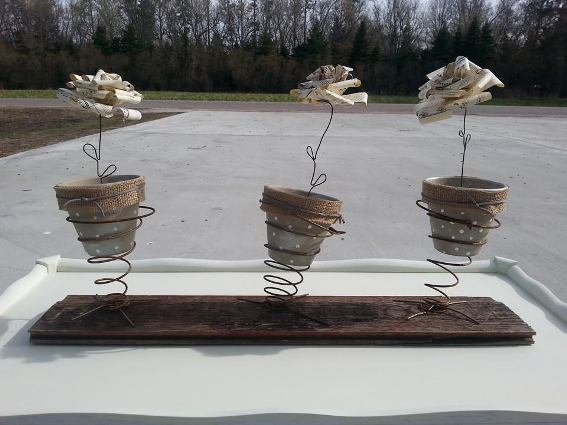 Sue made these Spring springs to hold flowe pots and her signature paperroses made from sheet music