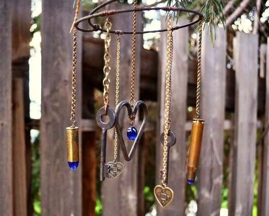 Marie Niemann's wind chime close-up, ...the key and the heart combo is her special 'signature.'