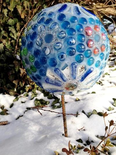 Carrie Guilliam's icy blue orb sits on a rebar rod