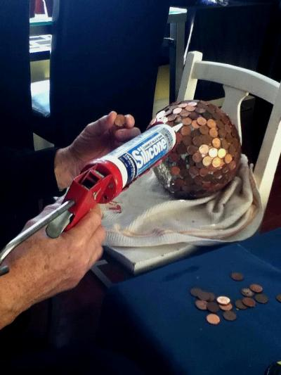 """Cathy Scott shows how she sets up her craft area to make a penny ball """"I work on gardening projects when it's too cold to plant here in Bourget, Ontario,"""" she says."""