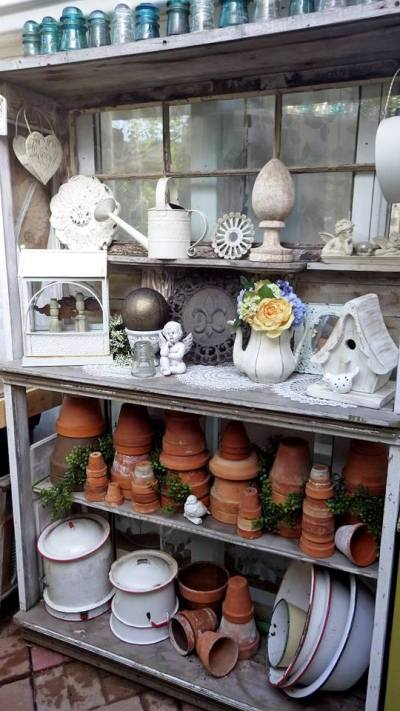 Ann's shelf full of terracotta and white garden objects