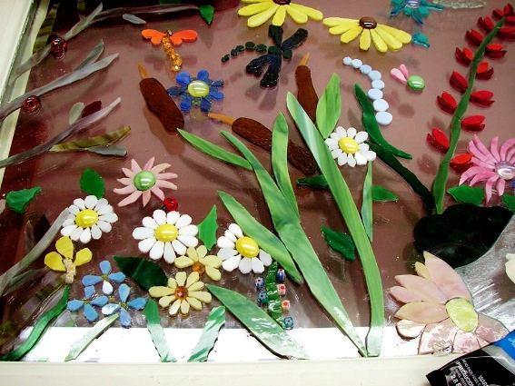 The flower arrangement takes shape