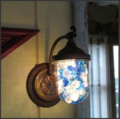Nancy Carter sparkled up her porch light with glass gems