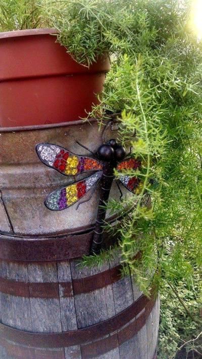 Tonya Fennig's dragonfly is nearly hidden amongst the fern on this barrel