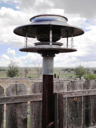 Linda N Eddie Garcia's galvanized chimney bird feeder