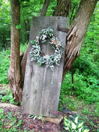 wreathed door in the forest, and my inspiration
