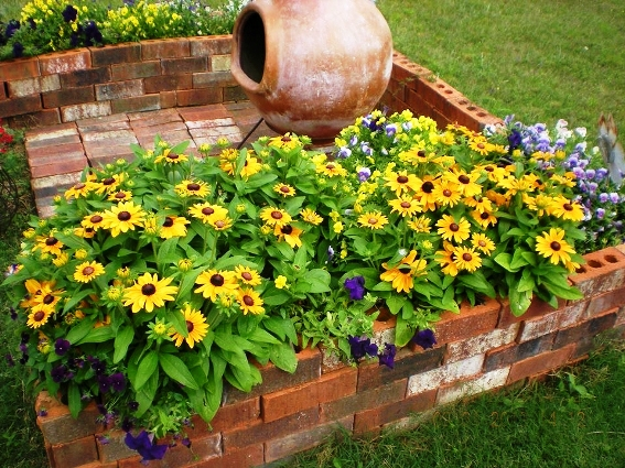 Billie Hayman uses hardscape to highlight her flowers and earthen pot