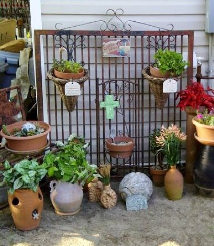 Alaine Yon's gate hung with succulent pots