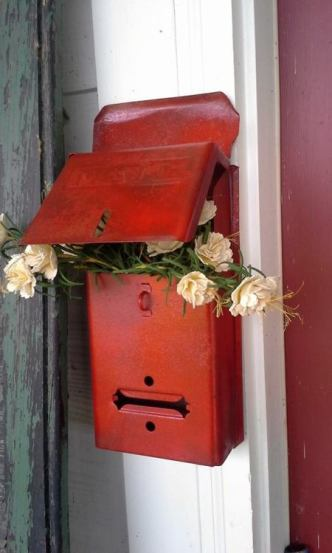 Billie Hayman's mailbox with roses tucked inside