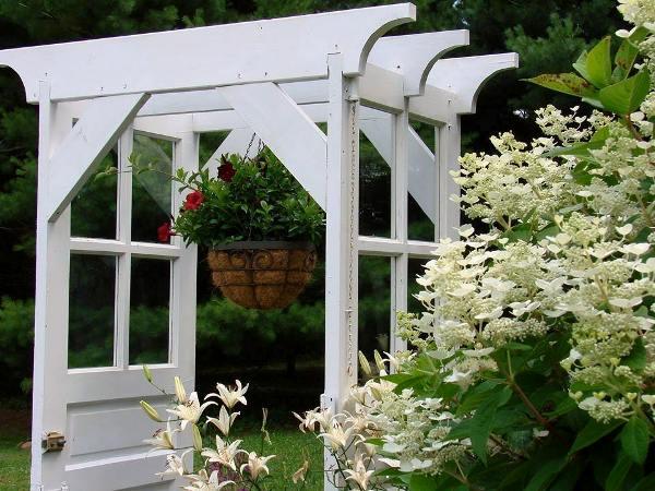 Blooms at the new \u0027old door arbor\u0027 now. You can see more construction & Jeanne\u0027s door arbor redo | Flea Market Gardening