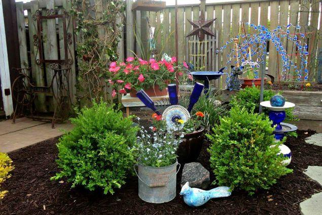 Linda Gladman's garden sparkler hovers daintily above her stunning vignette