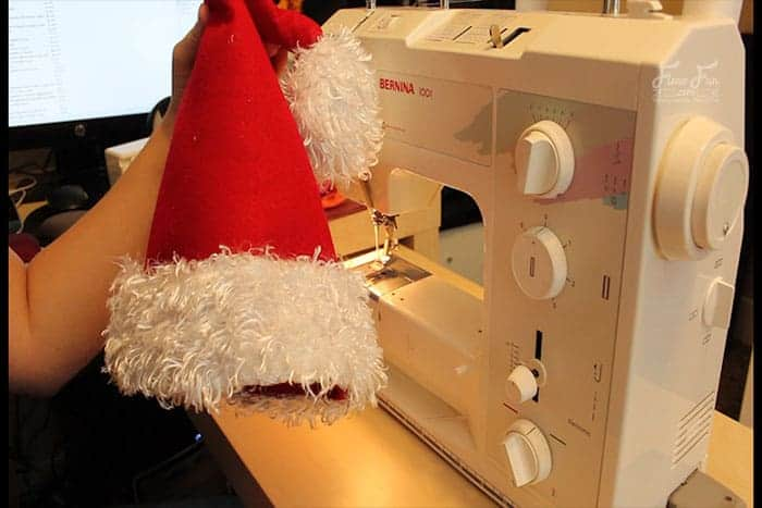 Step 5 - Turn the Santa Claus hat right side out. Easy Santa hat DIY with a free sewing pattern. Great sewing project for the holidays. Holiday sewing project that is beginner friendly. Love this Santa Hat How to.