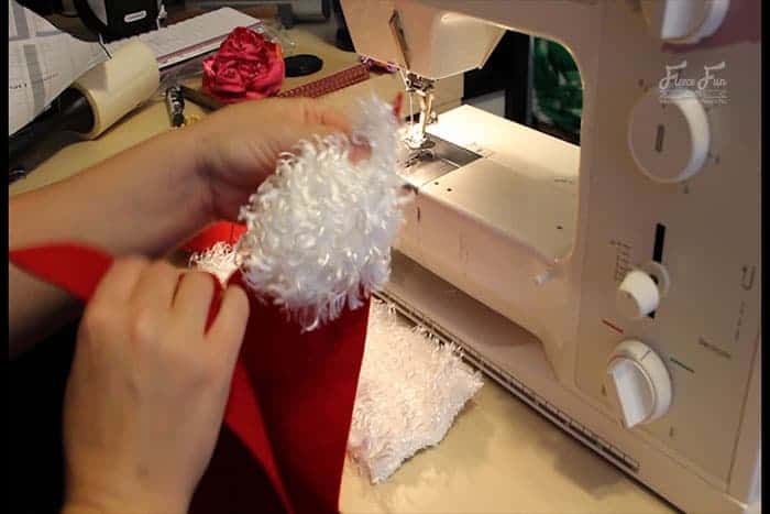 Step 3 - Sew all of the Santa Hat together. Easy Santa hat DIY with a free sewing pattern. Great sewing project for the holidays. Holiday sewing project that is beginner friendly. Love this Santa Hat How to.