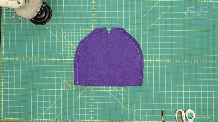 step 2 - sew the sides of the easy fleece hat. I love this easy basic fleece hat tutorial. I love the free pattern that comes with it. Perfect fleece sewing project. This winter hat comes in sizes baby to adult. Perfect sewing pattern for the whole family.
