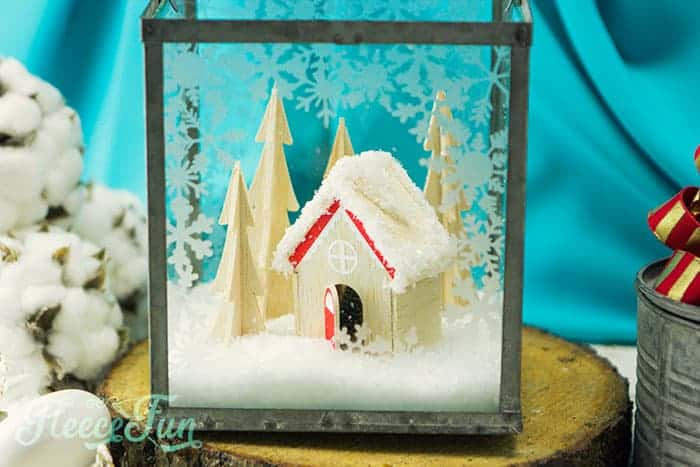 This Christmas Terrarium DIY features wooden elements for a different look. With step by step instructions and lots of pictures this holiday decoration comes together quickly.