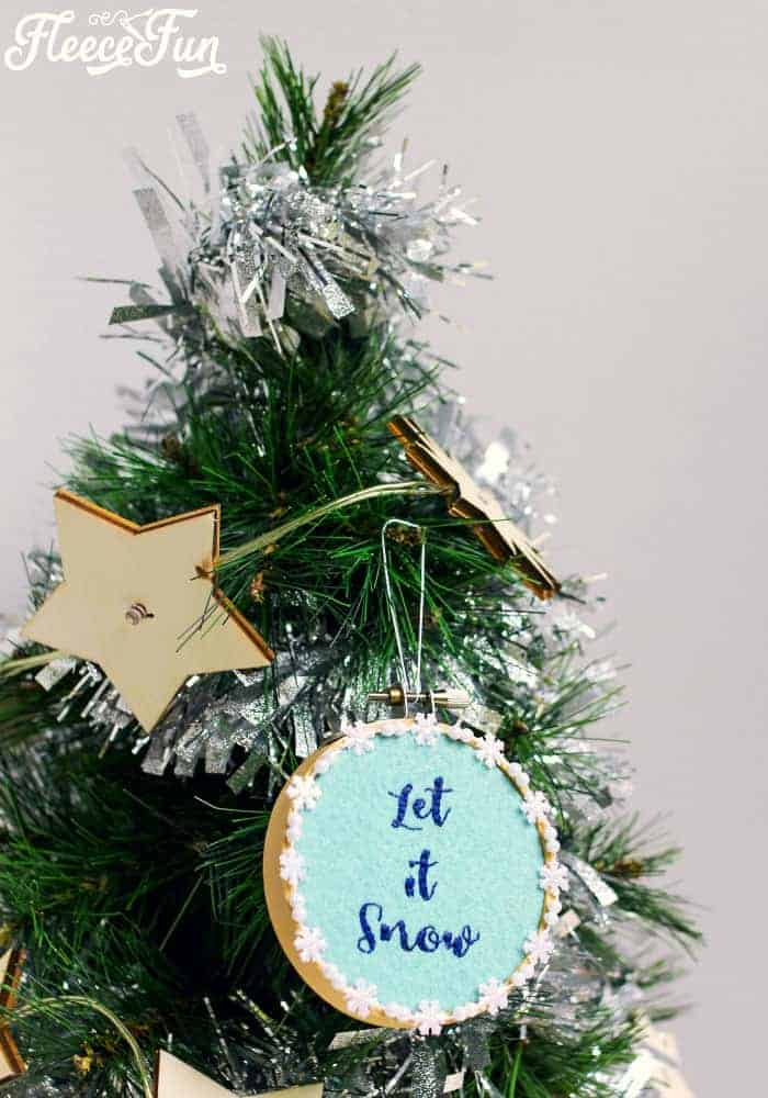 This Let it Snow Embroidery Hoop Ornament DIY makes a wonderful addition to your Christmas tree. Easy step by step instructions and free pattern make this Handmade Ornament a great Christmas craft.